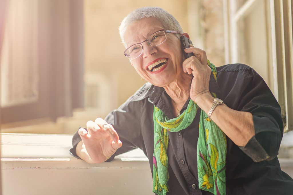 Older woman smiling on the phone